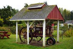 Greenbank Farm circa. 1904 (McCormick-Deering Farmall Tractor) (SonjaPetersonPh♡tography) Tags: whidbeyisland washington washingtonstate stateofwashington barns redbarn nikon nikond5300 greenbankfarm circa1904 historicsite historic heritage heritagebuilding heritageregisteredproperty whidbeypiescafe grocerystore store barn greenbank shops fields forests wetlands winetastingshop restaurant greenbankcheese artworksgallery robschoutengallery