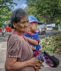 Grandma (Beegee49) Tags: street woman carrying child old elderly filipina boy sony a6000 portrait silay city philippines happyplanet