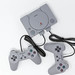 The Sony Playstation Classic mini console with two controllers on white background  - top view
