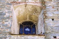 window..........stained glass (atsjebosma) Tags: raam stainedglass glasinlood blauw blue roof dak dove duif atsjebosma pistoia tuscany italy window old ancient wall muur roestig coth5
