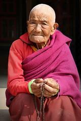 People of Nepal (Iam Marjon Bleeker) Tags: nepal boudhanath stupa monk pink red peopleofnepal dag24md0c1100g