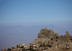 Village Posted On The Top Of A Mountain, Yemen (Eric Lafforgue) Tags: arabia arabiafelix arabianpeninsula architectural architecture blue bluesky building cliff colourpicture copyspace day fog hill historical history horizontal housing landscape mist mountain nopeople placeofinterest rock stone village yemen mg6132 hababa
