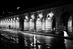 Under lanterns (pascalcolin1) Tags: paris13 homme man pont bridge lumière light reflets reflection lanternes lanterns route road nuit night photoderue streetview urbanarte noiretblanc blackandwhite photopascalcolin 50mm canon50mm canon