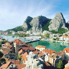 This is town of Omiš in Croatia, at the place where river Cetina meets the Adriatic Sea. The photo was taken from a fortress carved in the rock. Today it's a popular place to go rock climbing, white water rafting, kayaking, hiking etc (Dalmatica) Tags: cavingarea limestone proudcroatian outdooradventures outdoorsports kayaking whitewaterrafting hiking rockclimbing uskok history ancient square iphonephoto cetina river sceniccroatia overlook fortress dalmatia croatia omis omiš