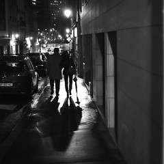 Coming down towards the light (pascalcolin1) Tags: paris13 homme man woman femme couple nuit night lumière light ombre shadows parapluie umbrella photoderue streetview urbanarte noiretblanc blackandwhite photopascalcolin 50mm canon50mm canon
