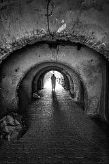 A story under every arch~ Marrakech (~mimo~) Tags: berber africa urban city outdoor people blackandwhite photography street tradition jellaba man medina marrakech morocco
