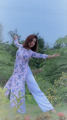 Performing Art (khoitran1957) Tags: aodai vietnam beauty beautiful girl woman nature garden