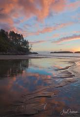 Little islands (Jerzy Orzechowski) Tags: beach sunset vancouverisland water island sky canada reflections sand orange clouds