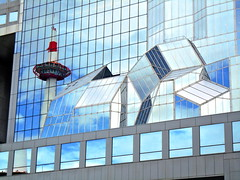 Kyoto tower and sky reflected on glass facade of Kyoto railway station (Germán Vogel) Tags: windows touristattractions tourism traveldestinations travel urbanlandscape modernarchitecture reflection facade glassfacade japan kyoto kyototower landmark kyotostation trainstation bullettrainstation railwaystation architecture