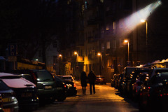 Pair walking in streetlighting (Maximus Viridius) Tags: sony a7 bratislava mirrorless 2870mm travel europe full frame slovakia street