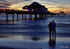 Enjoying a Beautiful Florida Sunset (pandt) Tags: sunset couple romance pier pier60 clearwater beach ocean waves sand water coast coastal gulfofmexico outdoor sky clouds vacation flickr canon eos slr rebel t1i florida people