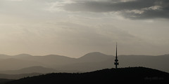 Telstra Tower in silhouette (astrogirl969) Tags: fujifilm xpro2 fujifilmxc50230mmf4567ois telstratower canberra mtainsleylookout dusk mutedcolours silhouette sunset clouds monochrome telephoto outdoor contrast landscape hills mountains structure communication sky 10faves
