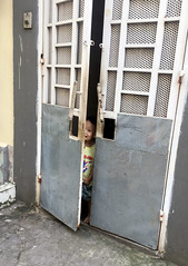 Behind the Door (cowyeow) Tags: door doors hanoi vietnam asia asian street urban city people candid littleboy young boy trainstreet travel shy