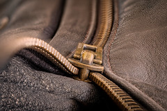 Unzipped (david.travis) Tags: leather zip texture clothing jacket metal