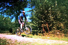 the jump (»alex«) Tags: film scan old outofdate disposable camera cycling mtb jump bike bicycle covert woods barham kent summer cyclist
