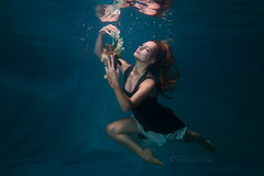 Woman is swimming under water with a flower in her hands. (Kladyk_Petro) Tags: dress cool attractive woman young caucasian water occupation female underwater beauty fashion splash sea activity adventure ocean concepts inspiration elegance relaxation swim under motion drops girl person bubble pool reflection hair action dive wet swimmer fantasy submerged diving mermaid float clothes art surreal artistic snorkeling dream undersea fabulous floating