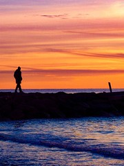 Hiker on Sea Wall (ZoKë) Tags: stroll harbor bay capecod cornhill sunset evening seawall pier jetty silhouette hiker person