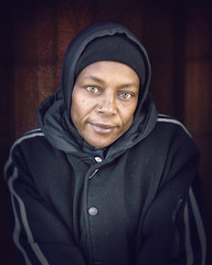 Doris (mckenziemedia) Tags: homeless homelessness woman hat stockingcap winter coat hood hoodie chicago street streetphotography portraiture portrait face smile people urban city