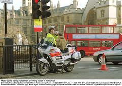 TrafficCopDrinking (hoffman) Tags: bus drinking horizontal london motorbike motorcycle outdoors parliament police policing street traffic uniform vehicle waiting davidhoffman wwwhoffmanphotoscom uk