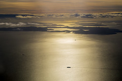 Islands Between Seattle and Vancouver (aaronrhawkins) Tags: vancouver seattle island silhouette aerial view airplane sky ocean ship boat backlit bright pacificnorthwest shipping aaronhawkins