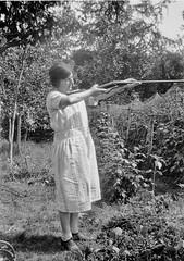 Woman with a rifle (vintage ladies) Tags: vintage blackandwhite photograph photo people female woman lady eoshe rifle gun dress