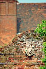 20110429 Garden of the Faces I ([Ananabanana]) Tags: nikon d40 gimp photoscape tamron tamron70300mmaff4556dildmacro tamronaf70300mmf456dildmacro tamronaff4556dildmacro 70300mmf456dildmacro 70300mmf456dildm 70300mm 70300 nikonistas nikonista hatfieldhouse hertfordshire hatfield herts garden gardens park wall brick face sculpture mask smile smiling peaceful