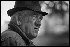Keen eye (Frank Fullard) Tags: frankfullard fullard candid street portrait gentleman hat farmer ballinasloe horsefair fair monochrome black white blanc noir face expression ryr keen sharp looking observer irish ireland
