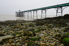 Pier Through the Rain (JamieHaugh) Tags: clevedon somerset england uk gb britain pier outdoors victorian sony alpha zeiss a7rii ilce7rm2 seaside sea rain wet weather rocks beach estuary channel bristol fishing brolly architecture pebbles coast seascape