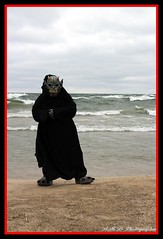 Paradox on the Grand Haven Beach (PhotoJester40) Tags: outdoors outside male paradox mask gargoyle grandhavenbeach waves posing amdphotographer