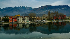 The village on the river (M-Gianca) Tags: fiume river italia italy sony zeiss acqua water boat barche lecco city città paese