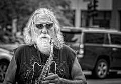 Chicago street performer.... (Kevin Povenz Thanks for all the views and comments) Tags: 2018 july kevinpovenz chicago illinios street streetphotography streetportrait streetperformer musician blackandwhite portrait canon7dmarkii candid man male horn sunglasses hair beard