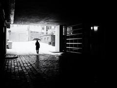 Snowfall (Sandy...J) Tags: street streetphotography sw schwarzweis strasenfotografie silhouette snow snowfall noir urban light darkness city monochrom blackwhite bw germany women umbrella olympus mood atmosphere