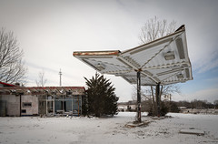 Abandoned Gas Station (Notley Hawkins) Tags: clouds cloudy sky cloudysky abandoned kingdomcity callawaycounty notley notleyhawkins 10thavenue gasstation stationdegaz distributoredibenzina postodegasolina gasolinera missouri httpwwwnotleyhawkinscom missouriphotography notleyhawkinsphotography ruralphotography tree awning dusk building architecture entropy 2019 winter janaury ice freeze puddle slush lightpaint lightpainting warmcool bluehour thebluehour canontse24mmf35lii snow snowyday