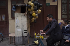 Nameless (Spontaneousnap) Tags: spontaneousnap street shanghai china city like candid documentary people publicareas lifestyle 上海 leicaq takeabreak afternoon asia bicycle balloon couple smoking