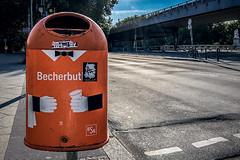 Butler (Melissa Maples) Tags: berlin deutschland germany europe apple iphone iphonex cameraphone underpass bridge street road orange bin deutsch german text becherbutler