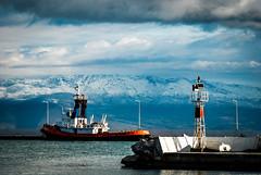 Another neighborhood photowalk (jimiliop) Tags: boat seaside mountains snow telescope light red blue heavysky