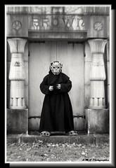 Paradox First Time Out (PhotoJester40) Tags: inside indoors mask costume mausoleum gargoyle bnw bw blacknwhite blackandwhite blackwhite amdphotographer noirblanc paradox