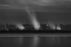 "moody black & white fine art long exposure - Le Havre industry across the Seine, taken from Honfleur, Calvados, Normandie, France (grumpybaldprof) Tags: canon 70d ""canon70d"" tamron 16300 16300mm ""tamron16300mmf3563diiivcpzdb016"" bw blackwhite ""blackwhite"" ""blackandwhite"" noireetblanc monochrome ""fineart"" ethereal striking artistic interpretation impressionist stylistic style contrast shadow bright dark black white illuminated mood moody atmosphere atmospheric ""longexposure"" ""neutraldensity"" nd ""lehavre"" ""seinemaritime"" normandie normandy france ""francois1"" 1517 port ""containerport"" ""newindustry"" ""windturbines"" aeronautics ""devastatedww2"" trade ""oilindustry"" ""unescoworldheritagesite"" ""andremalrauxmodernartmuseum"" ""oceanliners"""