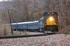 CSX 74th Annual Santa Train in 2016 rounding the curve through Boody, VA. (Railroad Gal) Tags: csx santatrain csx4384 santatrain2016 clinchfield clinchfieldrailroad crr fallenflag passengertrain tradition railfan femalerailfan railroad boodyva stpaulva castlewoodva southwestva appalachianmountains appalachian foliage fallfoliage autumn landscape mountains sd403 emd diesellocomotive santa rocks trees leaves