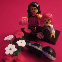 MM 26 November 2018: Smell the truth (jefalump) Tags: macromondays dotsandstripes lego minifigure minifigs flowers skunk camera macro red