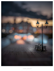 Take a seat (John Joslin) Tags: cromer england uk streetlamps bokeh pier town lights boardwalk promenade sky clouds twilight evening dusk winter sunset bench light travel