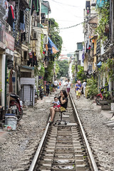 Chill (mystero233) Tags: chill relax hanoi vietnam girl baby chair train railroad trainstreet asia normal street city town capital holiday travel traveller colours colorfull house mother sit