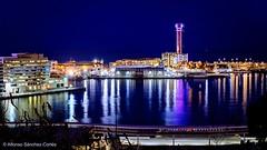Barcelona ❤️. (alfonsoscg) Tags: barcelona fujifilm xt20 500 mm noche port puerto montjuic azul blue mar sea mediterraneo barcos embarcaciones hotel reflejos marenostrum rojo red
