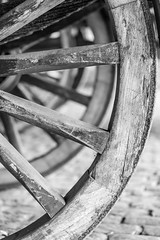 Wheel behind a wheel behind a wheel in black and white (YvonSteenbergen) Tags: wheel cart blackandwhite monochrome spoke detail stock oldcart wheels blackwhite old wood historic wooden handcraftfarm western retro round agriculture nostalgia move handmade transportation weathered outdoors antique past carriage nobody material aged brown vehicle closeup vintage cartwheel timber historical rotation wagon rural craft history behind handwork transport rustic