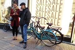 SALE (theo_vermeulen) Tags: kalverstraat amsterdam people phone bicycle cap street candid