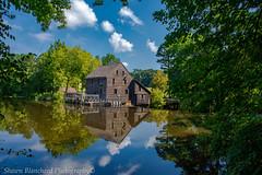Yates Mill (Shawn Blanchard) Tags: yates mill pond raleigh northcarolina nc north carolina clouds color blue building white wood trees green water reflection rocks waterfall