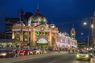 Flinders St Station lit in Christmas colours