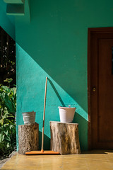 Pisté, Yucatán, Mexico (ChrisGoldNY) Tags: challengefactory challengewinners chrisgoldny chrisgoldphoto chrisgoldberg sonyalpha sonya7rii sonyimages licensing forsale bookcover albumcover yucatán mexico mexican latinamerica green pastel brooms treestumps frontporch light shadow door architecture color colorful colourful colours buckets pisté
