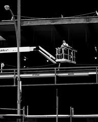 Raised up (George Stastny. Photographer.) Tags: street streetphotography streets monochrome blackandwhite bnw bw edmonton alberta canada getolympus olympus omd