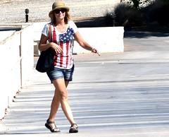 Turning the corner (thomasgorman1) Tags: walking woman street marina arizona outdoors travel az nikon zoom smile smiling candid public streetphotos streetshots sunglasses